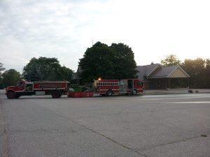 Fire trucks but no smoke plume